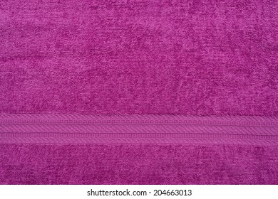 Terry lilac colored cloth towel texture as a background
