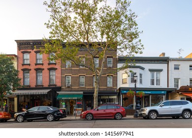 Terrytown, New York / USA - June 2 2019: city buildings facade on main street.