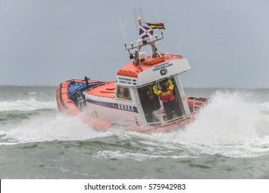 TERSCHELLING, THE NETHERLANDS, AUGUST 12 2016: Dutch coast guard is practising in tough weather in there rescue boat.