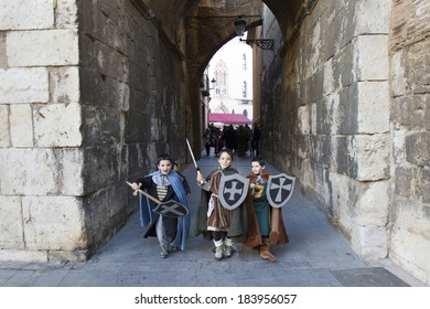 TERUEL, SPAIN - FEBRUARY 22 2014: Participants during rendering of the medieval festival of Bodas de Isabel de Segura recreating the legend of the Lovers of Teruel during the third weekend in February