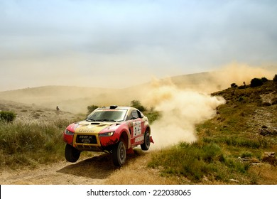 TERUEL, SPAIN - JUL 19 : Qatari driver Nasser Al-Attiyah and his codriver Matthieu Baumel in a HRX Ford race in the XXXI Baja Spain, on Jul 19, 2014 in Teruel, Spain.