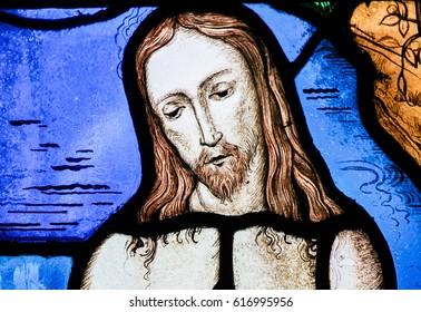 TERVUREN, BELGIUM - MARCH 13, 2017: Stained Glass in the Church of Tervuren, Belgium, depicting Jesus Christ