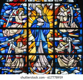 TERVUREN, BELGIUM - MARCH 13, 2017: Stained Glass in the Church of Tervuren, Belgium, depicting Mother Mary and the Dogma  of the Immaculate Conception