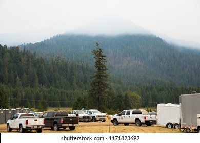 Terwilliger Fire Camp, OR, USA - August 30, 2018: Trucks and emergency vehicles at the base camp for the Terwilliger Fire management team.