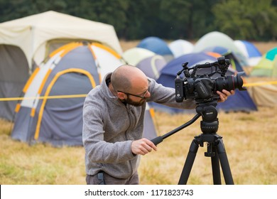 Terwilliger Fire Camp, OR, USA - August 30, 2018: Keith Testerman of Heartwood Films uses a video camera to film the fire base camp at the Terwilliger Fire in Oregon.