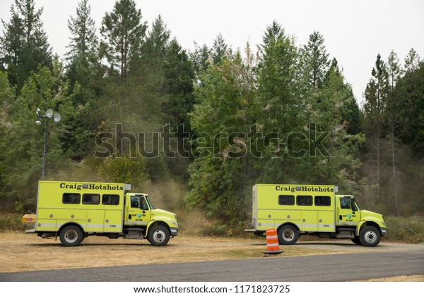 Terwilliger Fire Camp, OR, USA - August 30, 2018: Craig Hotshots fire trucks prepare to battle the blaze of the Terwilliger Fire in the Willamette National Forest of Oregon.