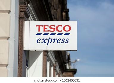 Tesco Express sign, Station Rd, Nottingham, Nottinghamshire, UK - 3rd April 2018