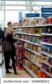 Tesco supermarket, Brighton and Hove, England, 2018. Customers shopping for food and household products in the Hove branch of Tesco, the U.K.'s biggest supermarket chain.