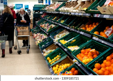 Tesco supermarket, Brighton and Hove, England, 2019. Customers shopping for fruit in the Hove branch of Tesco. There are worries over a shortage of food products if a no deal Brexit occurs.