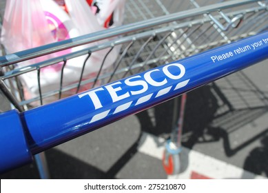 Tesco supermarket shopping trolley with a small amount of shopping inside. Taken on April 26th 2015 in Dudley. Tesco is facing dwindling sales following stiff competition from budget supermarkets