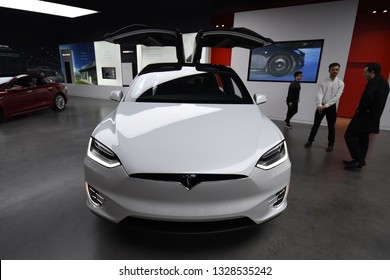 Tesla white Model X P100D all electric car on display at a Tesla car dealership, Chicago, IL November 24, 2018