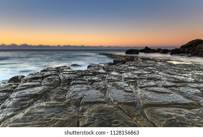 Tessellated Pavement and Sunrise Seascape - Capturing the sunrise from Forresters Beach on the Central Coast, NSW, Australia.