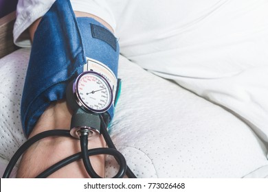 Test with a blood pressure meter. The man has the blood pressure tested. High score, hypertension. Health problems, heart problems. Holesterol. Medicine and health problems concept.