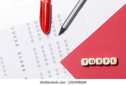 Test of English multiple choice on table. Woman takes an entrance exam