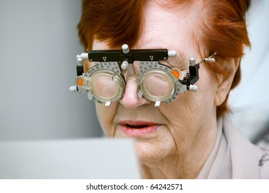 Test examination of an elderly woman at an optician clinic