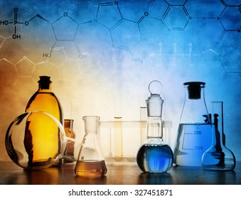 Test glass flask with solution in research laboratory. Science and medical background. Focus in the foreground.