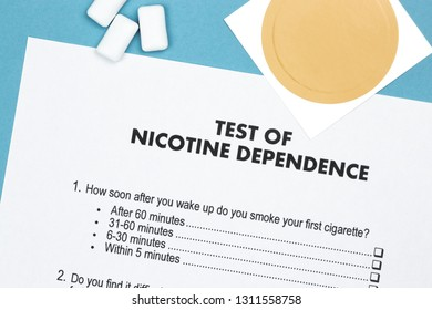 Test of Nicotine Dependence with substitute patch and gums on blue background