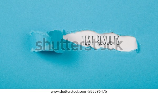 Test Results message on torn blue paper revealing secret behind ripped opening.