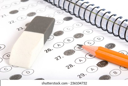 Test score with pencil, notebook and eraser
