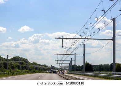 Test track with electric overhead contact wire for hybrid trucks on E-Highway in Luebeck, Germany, copy space