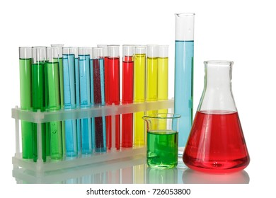 Test tubes with colorful liquids in a rack, a chemical flask and a beaker isolated on a white background.