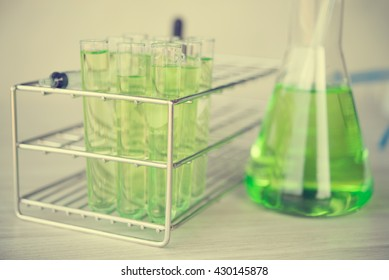 Test tubes in green tone.