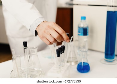 Test tubes in laboratory assistant's hands