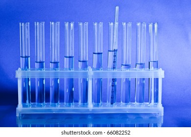 Test tubes with liquid over blue background