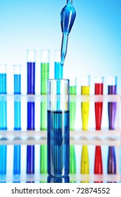 Test tubes over blue background