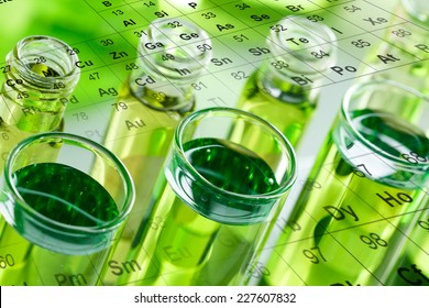 Test tubes, with periodic table, in laboratory