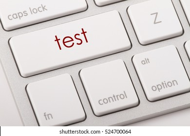 Test word written on computer keyboard.