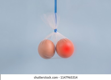 Testicular cancer concept: eggs representing testicles in a tulle bag