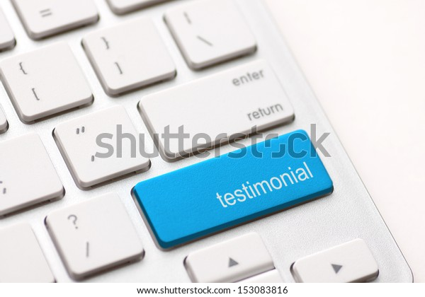 Testimonial button key on white keyboard.