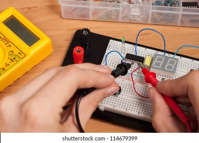 Testing electrical circuit on breadboard with voltmeter