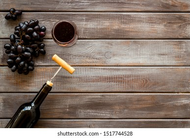 Testing wine concept. Top view dark wooden background copy space