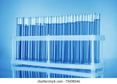 Test-tubes on blue background