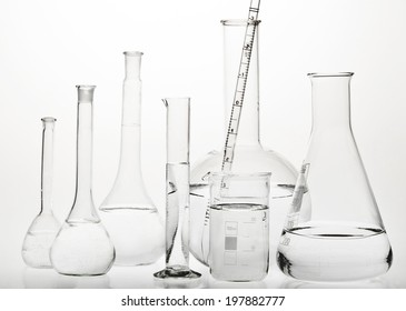 Test-tubes with reflections on a white background. Laboratory glassware.