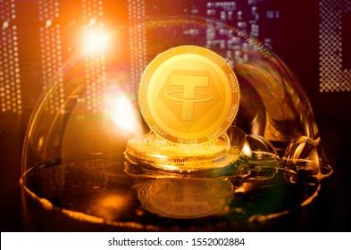 Tether bubble. Tether USDT coin in a soap bubble. Dangers and risks of investing to tether cryptocurrency. Speculation