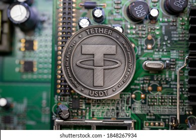 Tether USDT cryptocurrency physical coin placed on micro sheme. Macro Shot.