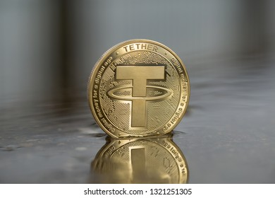 Tether USDT cryptocurrency physical placed in the water swamp on the street. Selective focus.