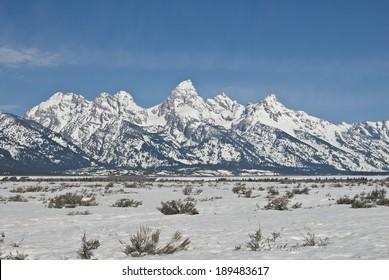 The Teton Mountain Range and sagebrush steppe of Wyoming near Jackson Hole in Spring.
