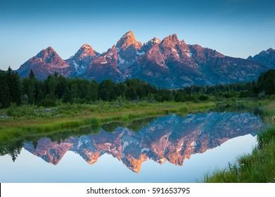 Teton Mountains bathed in Alpenglow Morning Light