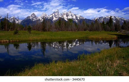 Teton's reflected in side channel of the Snake River, Grand Teton National Park, Wyoming