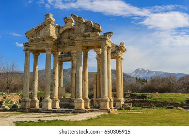 The Tetrapylon ruins, once a monumental gate in Aphrodisias Turkey with view of mountains in the background