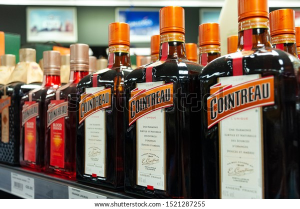 Teveren/Germany - September 27, 2019: Row of Cointreau liqueur on liquor store shelf.