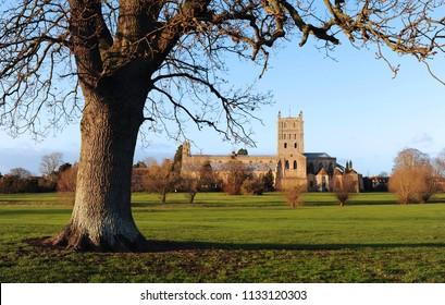 Tewkesbury Abbey near sunset in winter.
