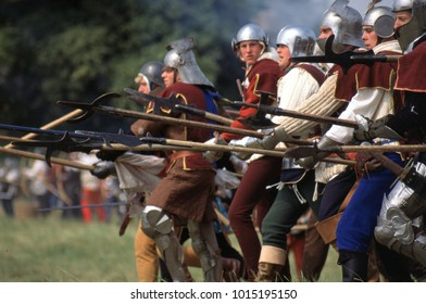 Tewksbury England 1995. Reenactors wearing period Tudor armour of the Wars of the Roses form a defensive line of pikes in a re-enactment of the Battle of Tewksbury 1471.