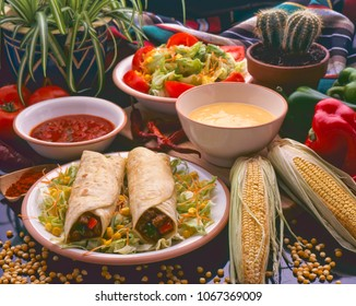 Tex Mex Food. Mexican burritos served with hot chili sauce and cheese dip.