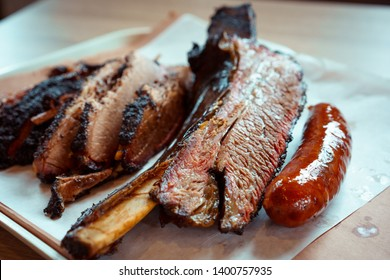 texas bbq style tray with rib brisket and sausage