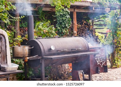 Texas Charcoal offset smoker during backyard cookout